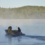 Netting crew leaving for work in a motorboat