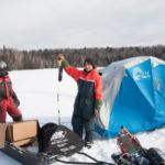 Field staff on Welcome lake, one is holding up a telemetry reciever